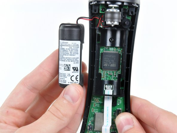 Removing the battery in the PlayStation Move controller teardown